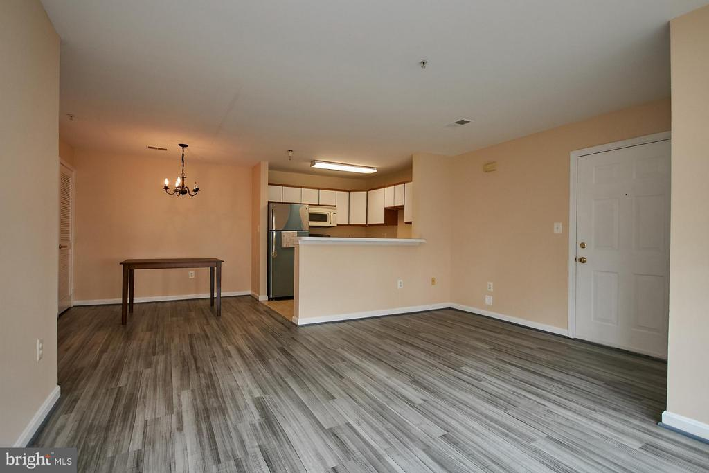 Dining Room with Adjoining Kitchen - 645 CONSTELLATION SQ SE #A, LEESBURG