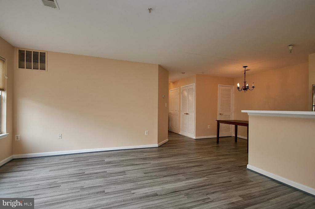 Living Room with a View to the Separate Dining Roo - 645 CONSTELLATION SQ SE #A, LEESBURG