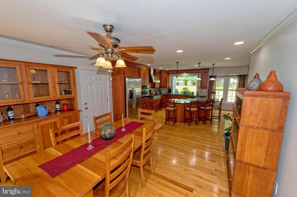 Open to dining area. Beautiful wood floors. - 43337 WAYSIDE CIR, ASHBURN