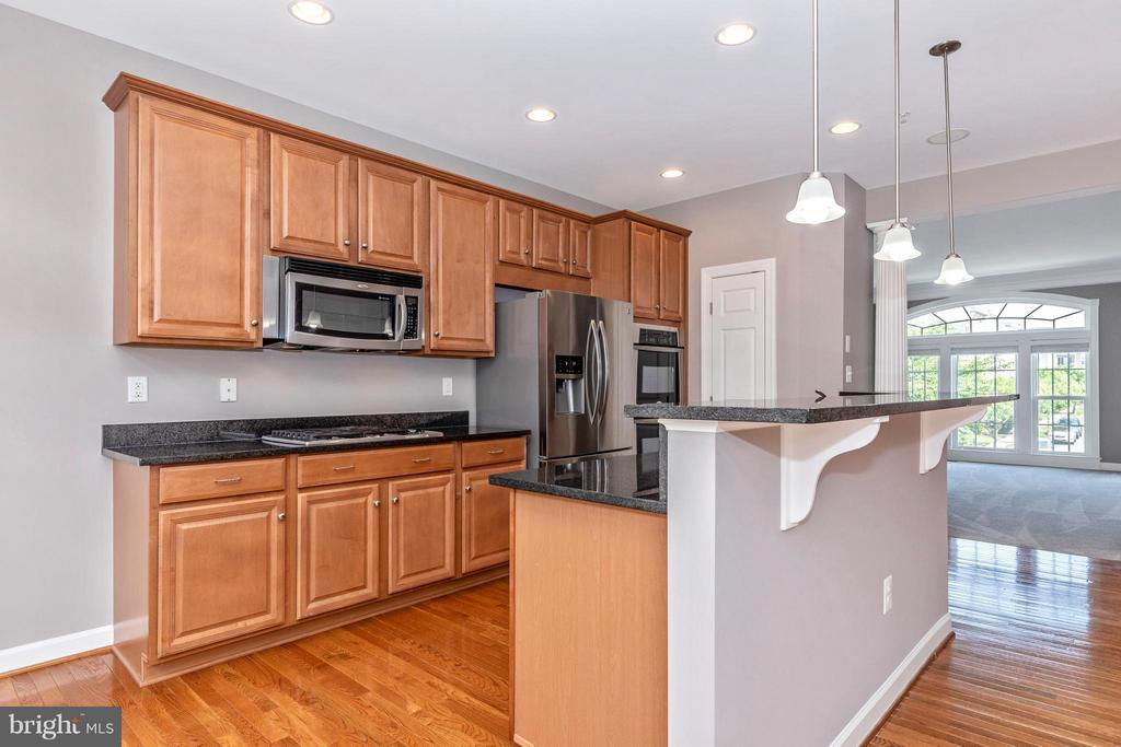 Kitchen with gleaming Hardwood Floors! - 8937 AMELUNG ST, FREDERICK