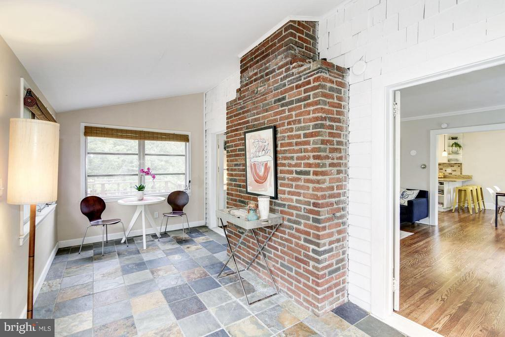 Sunroom with slate tile floor - 3403 CHEVERLY AVE, CHEVERLY