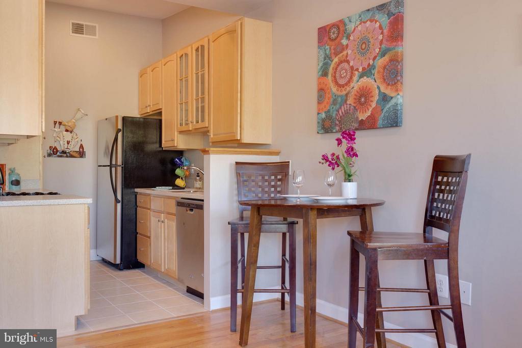 Kitchen open to living space - 223 FLORIDA AVE NW #4, WASHINGTON