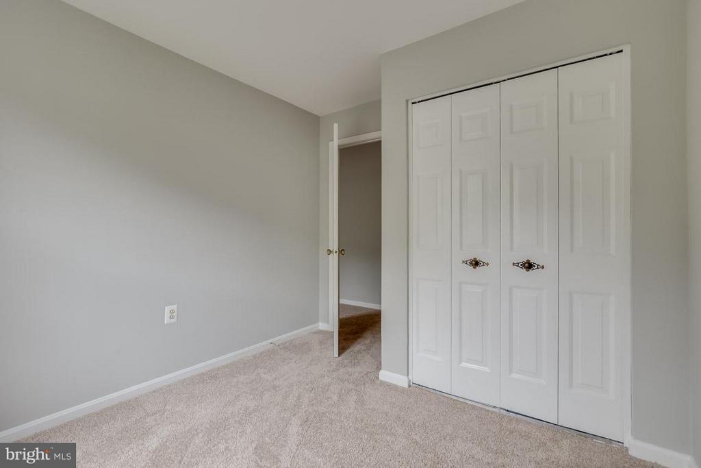 Bedroom 2 features double bifold doors - 11922 GLEN ALDEN RD, FAIRFAX