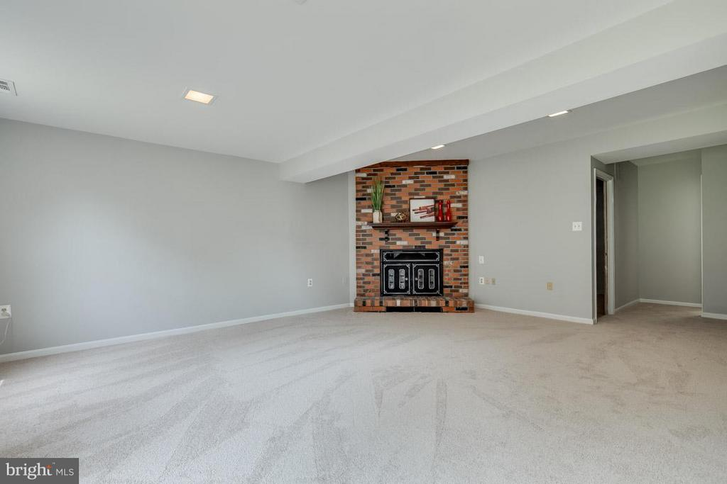 Huge recreation room with wood burning fire place. - 11922 GLEN ALDEN RD, FAIRFAX