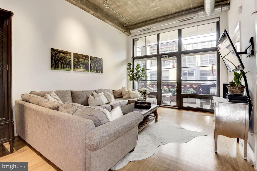 LIVING ROOM WITH STUNNING FLOOR-TO-CEILING WINDOWS - 2328 CHAMPLAIN ST NW #320, WASHINGTON