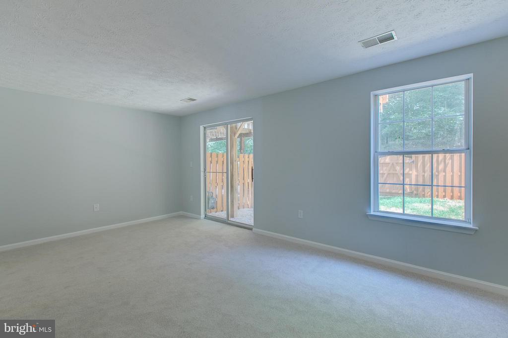 Rec room leads to back yard - 508 WATERS COVE CT, STAFFORD