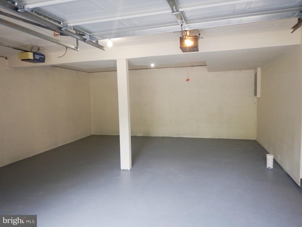 Garage with Painted Floor and New Garage Doors - 5700 TENDER CT, SPRINGFIELD