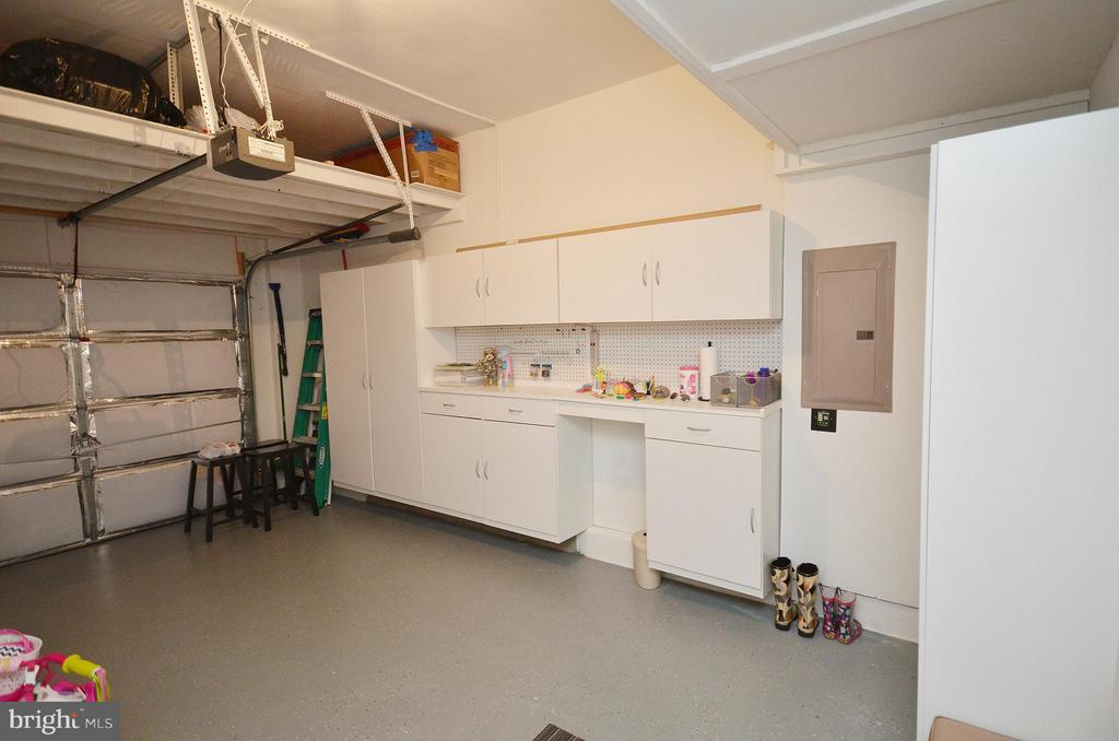 Garage with Tons of Storage and Shelving - 19442 DIAMOND LAKE DR #19442, LEESBURG