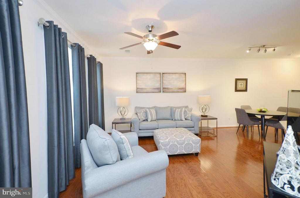 Living Room with Gleaming Hardwood Floors - 19442 DIAMOND LAKE DR #19442, LEESBURG