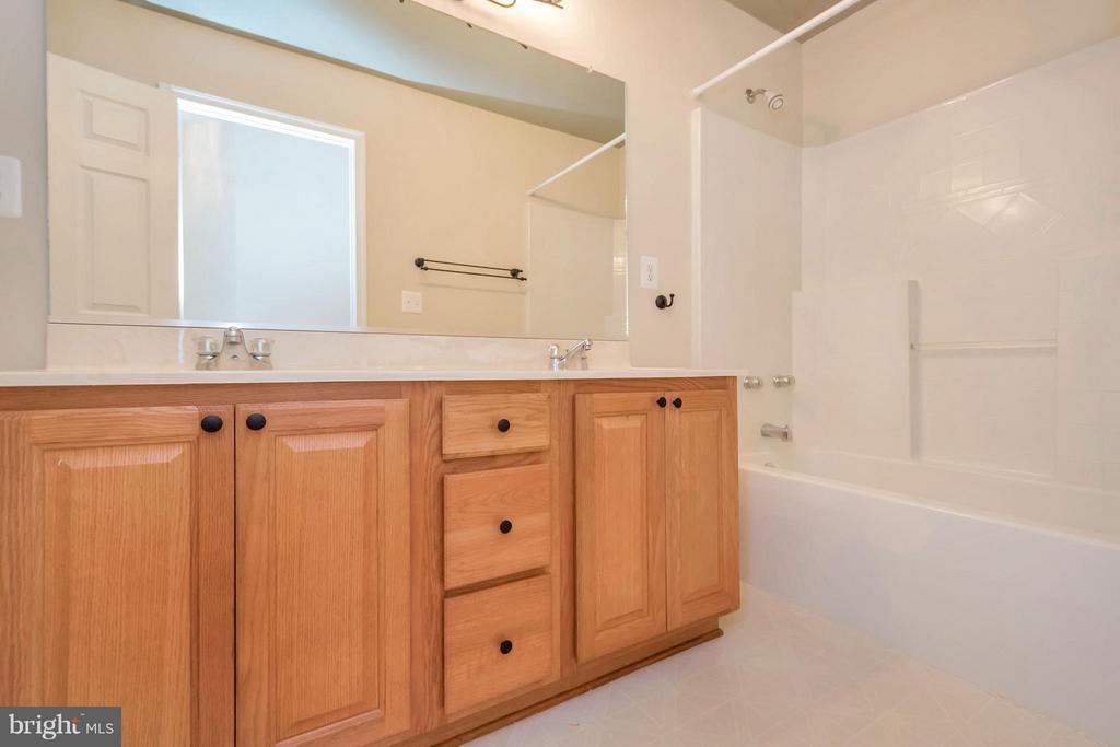 Hall Bath Boasts dbl vanity and a linen closet - 13200 CHANDLER CT, FREDERICKSBURG