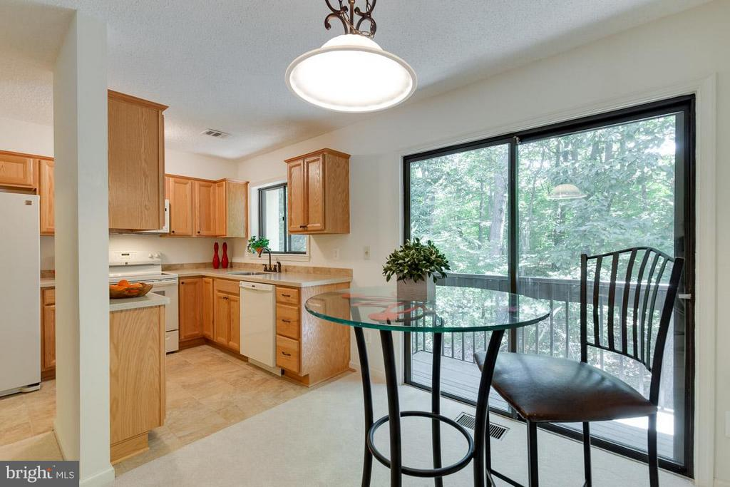 Dining room open to kitchen and rear balcony - 2104 CARTWRIGHT PL, RESTON