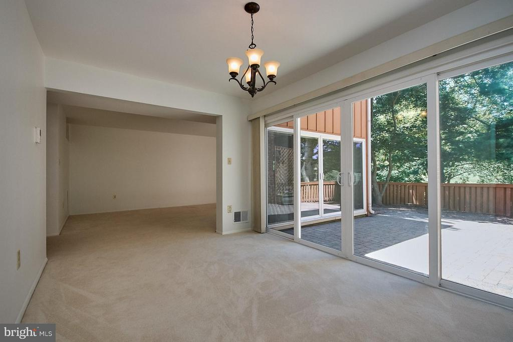 Dining Room with sliding glass doors to patio - 11462 LINKS DR, RESTON