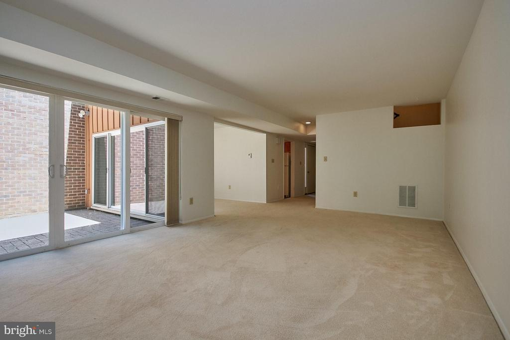 Living Room with sliding glass doors to patio - 11462 LINKS DR, RESTON
