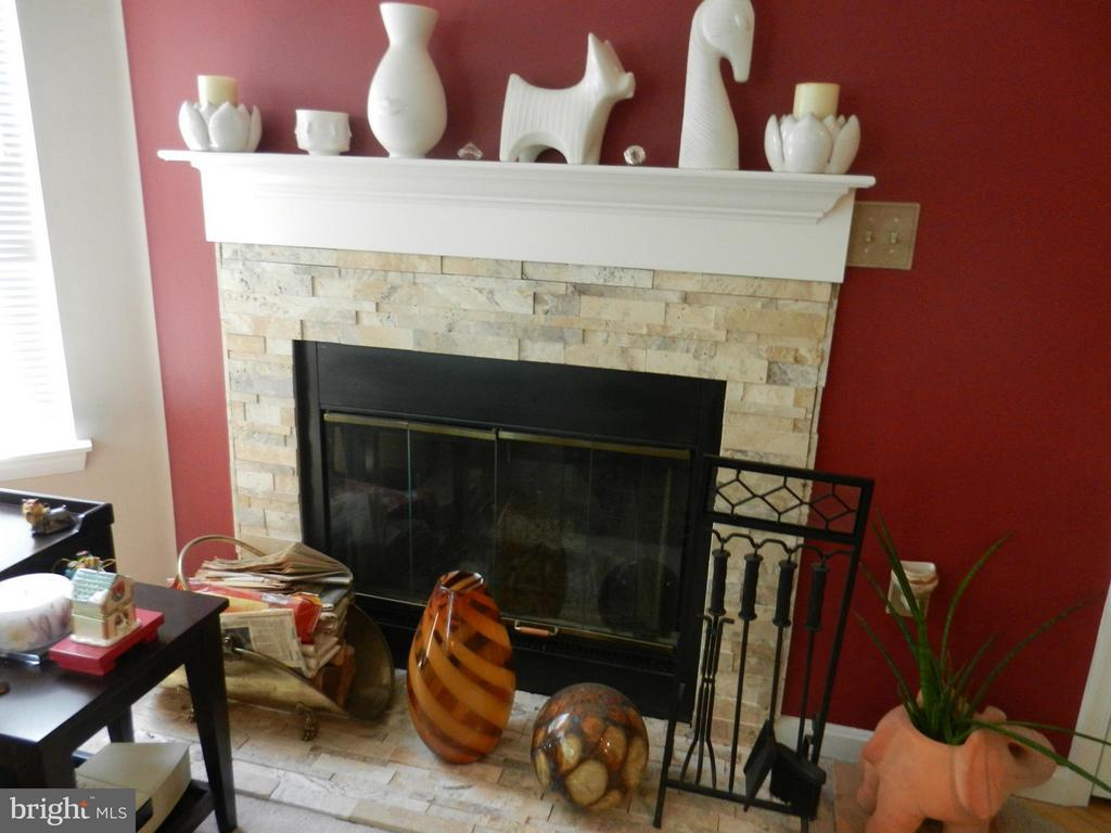 Fireplace has been redone with lovely stone front - 5612 WILLOUGHBY NEWTON DR #16, CENTREVILLE