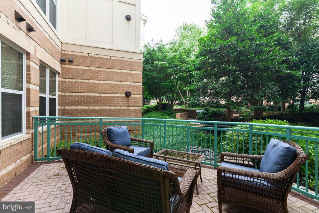 Large patio overlooking courtyard - 12000 MARKET ST #151, RESTON