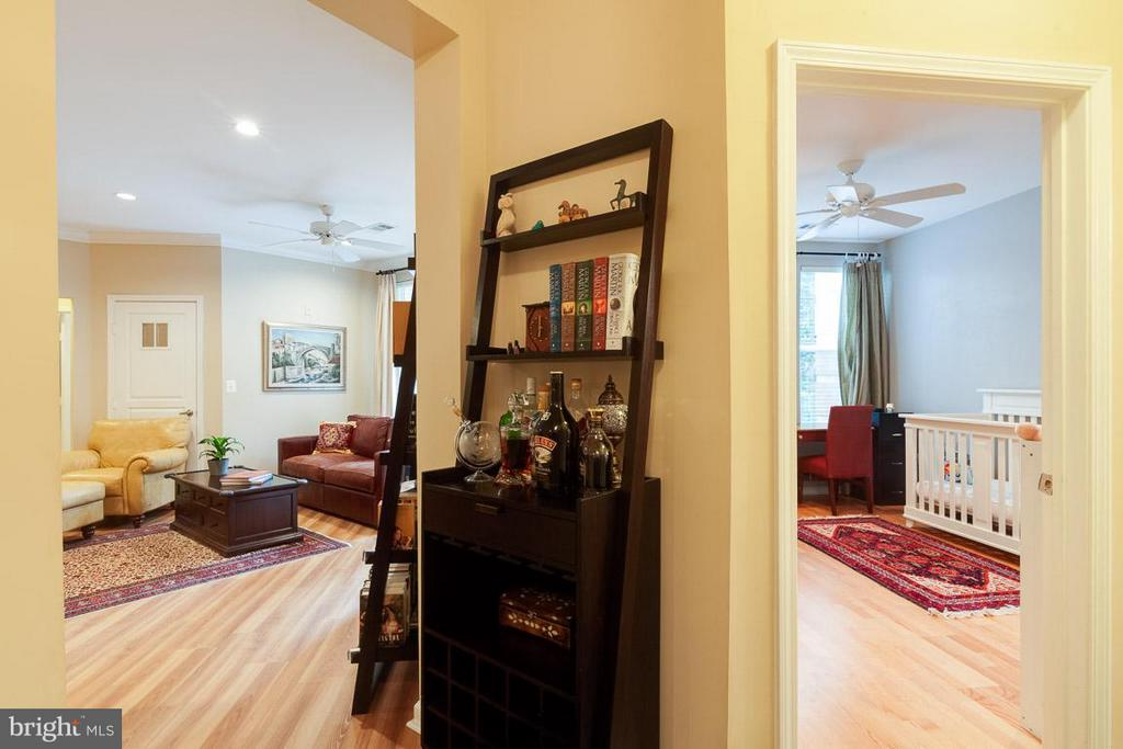View into living room and second bedroom from hall - 12000 MARKET ST #151, RESTON