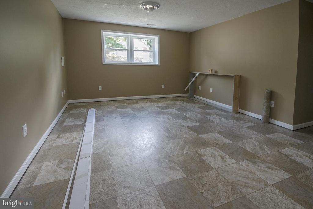 Lower level has 2 large rooms.  Could be 2 BRs - 53 WILLOW BRANCH PL, FREDERICKSBURG