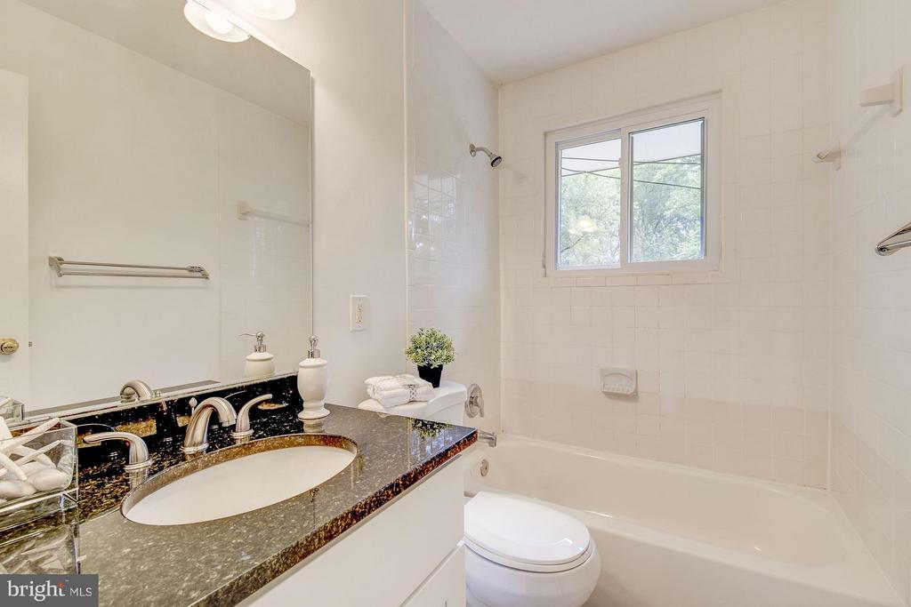 Main Level Bathroom with Granite Counter - 4416 LYONS ST, TEMPLE HILLS
