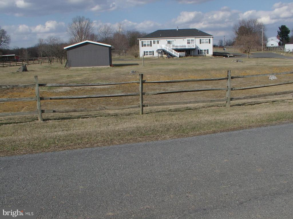 Street view of home w/rail fencing - 1919 WITHERS LARUE RD., BERRYVILLE