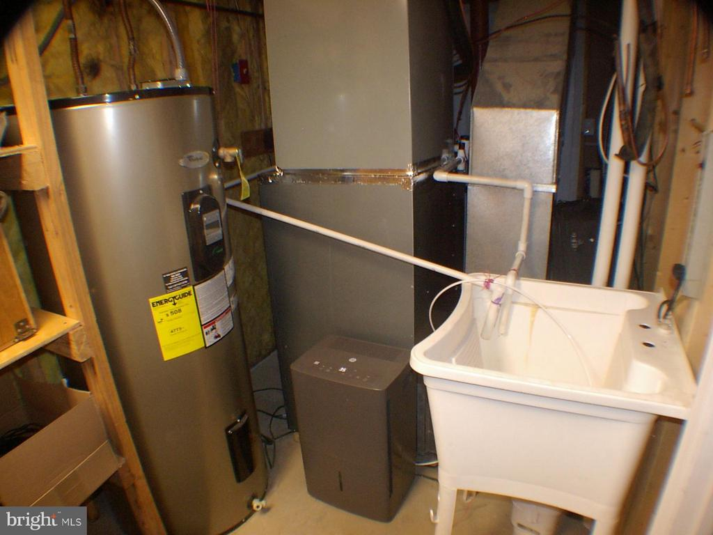 Big 80 gallon water heater in utility room - 1919 WITHERS LARUE RD., BERRYVILLE