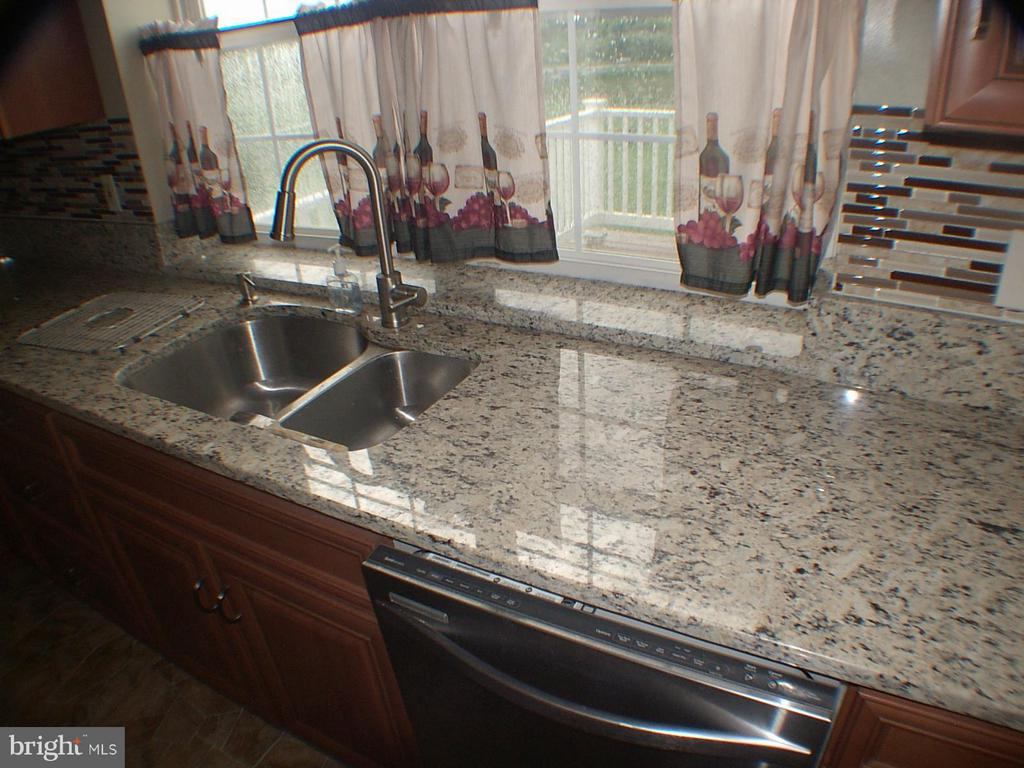 Granite ctcp and granite in pass-thru to deck - 1919 WITHERS LARUE RD., BERRYVILLE
