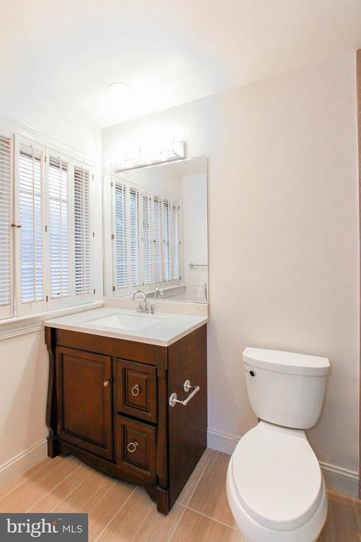 Each bathroom features an ensuite bath - 612 LIVE OAK DR, MCLEAN