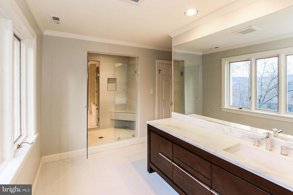 His and her bathrooms with adjoining shower - 612 LIVE OAK DR, MCLEAN