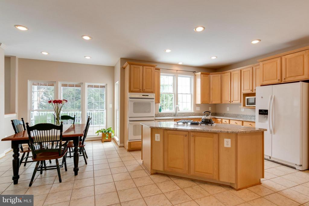 Kitchen leads to screened porch and deck. - 3849 GLASGOW WAY, FREDERICK