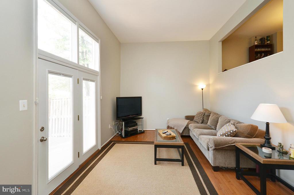 Family Room with hardwood flooring & newer doors - 2352 HORSEFERRY CT, RESTON