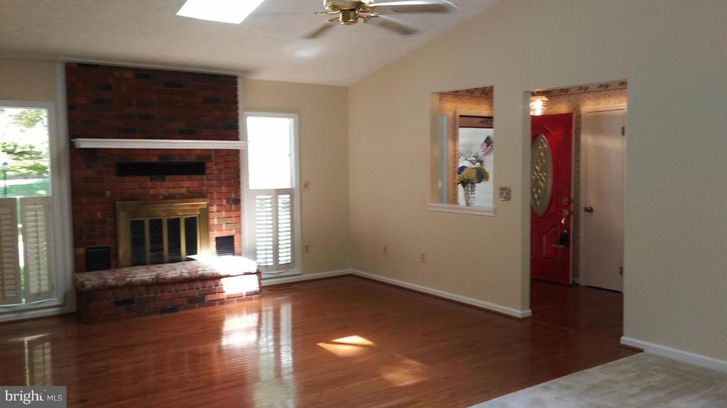 Cozy Brick Fireplace and Plantation Shutters - 113 SILVER SPRING DR, LOCUST GROVE