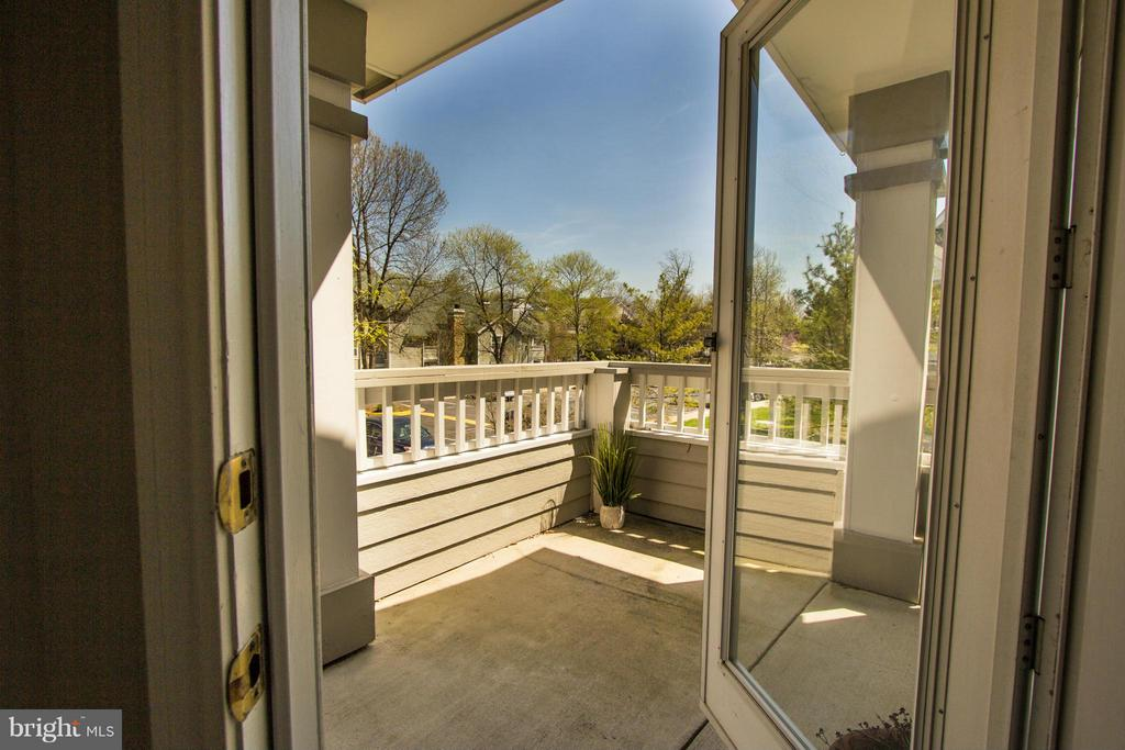 Large balcony accessed through living room - 13060 AUTUMN WOODS WAY #201, FAIRFAX