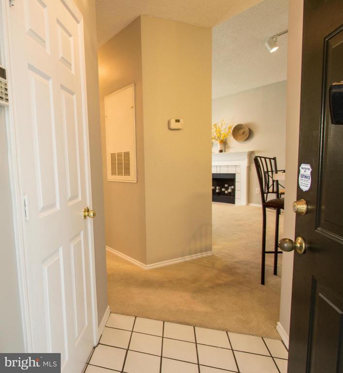 Foyer with coat closet - 13060 AUTUMN WOODS WAY #201, FAIRFAX