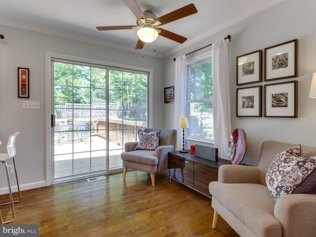 Family room abuts the kitchen + leads to the deck - 4700 CARE DR, ALEXANDRIA