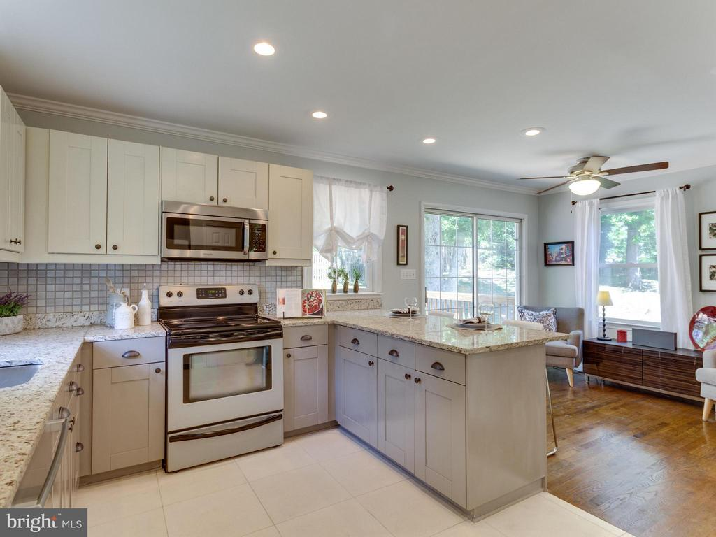 Kitchen has views of the gorgeous yard and deck - 4700 CARE DR, ALEXANDRIA