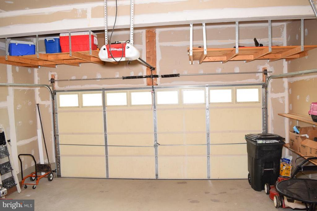 Garage with Added Shelving for Storage - 6016 PRESWELL CT, GAINESVILLE