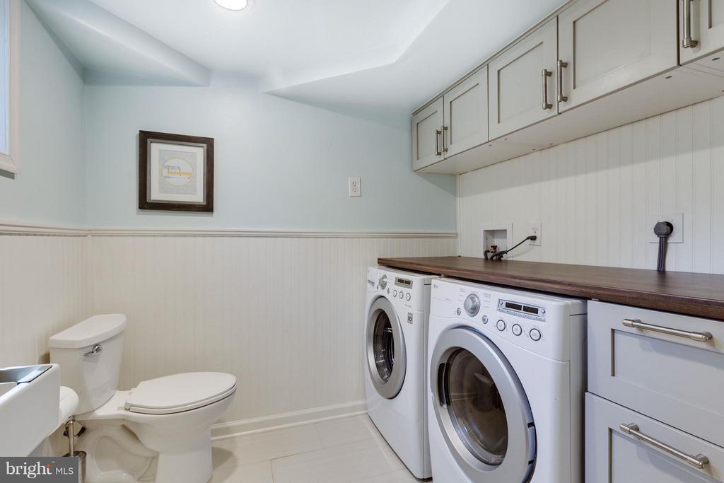 Newer washer & dryer, folding area and storage - 5312 TRUMAN AVE, ALEXANDRIA