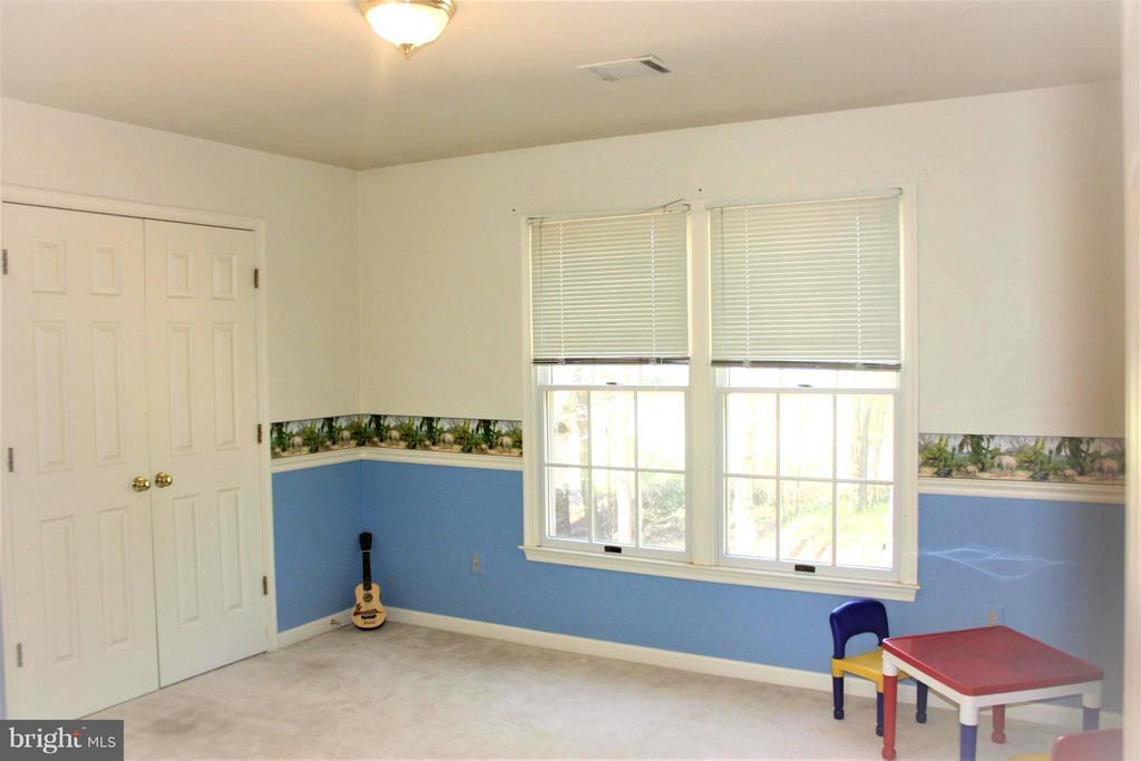 Bedroom with view of treed back yard - 46437 ESTERBROOK CIR, STERLING