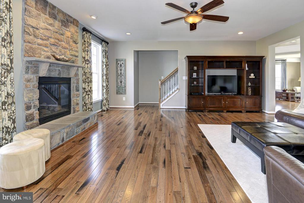 Another staircase to the upper levels from here - 16545 LEVADE DR, LEESBURG