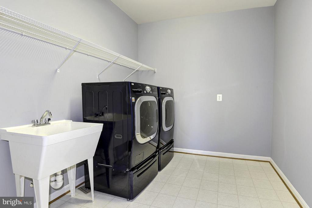 Large laundry room on 2nd level - 16545 LEVADE DR, LEESBURG