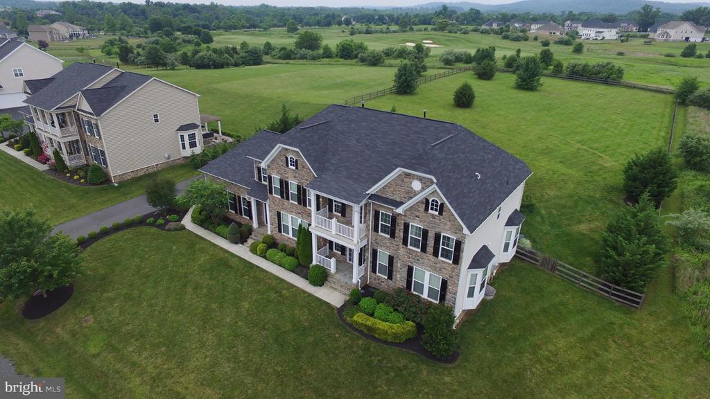 View of the front & back yards - 16545 LEVADE DR, LEESBURG