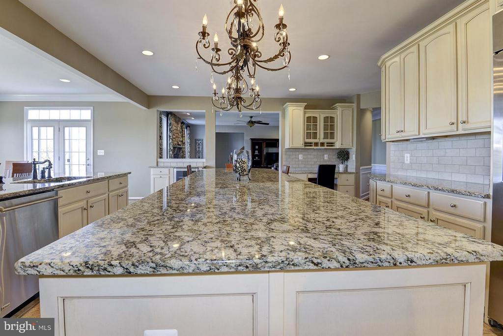 This kitchen island is MASSIVE - two chandeliers!! - 16545 LEVADE DR, LEESBURG