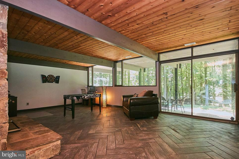 Family Room with wood ceiling and sliders to patio - 6704 BRIARCROFT ST, CLIFTON