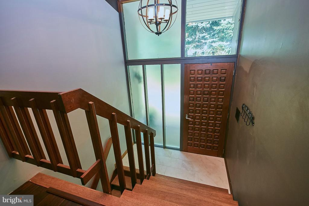 Incredible entry with ceramic tile, wooden door. - 6704 BRIARCROFT ST, CLIFTON