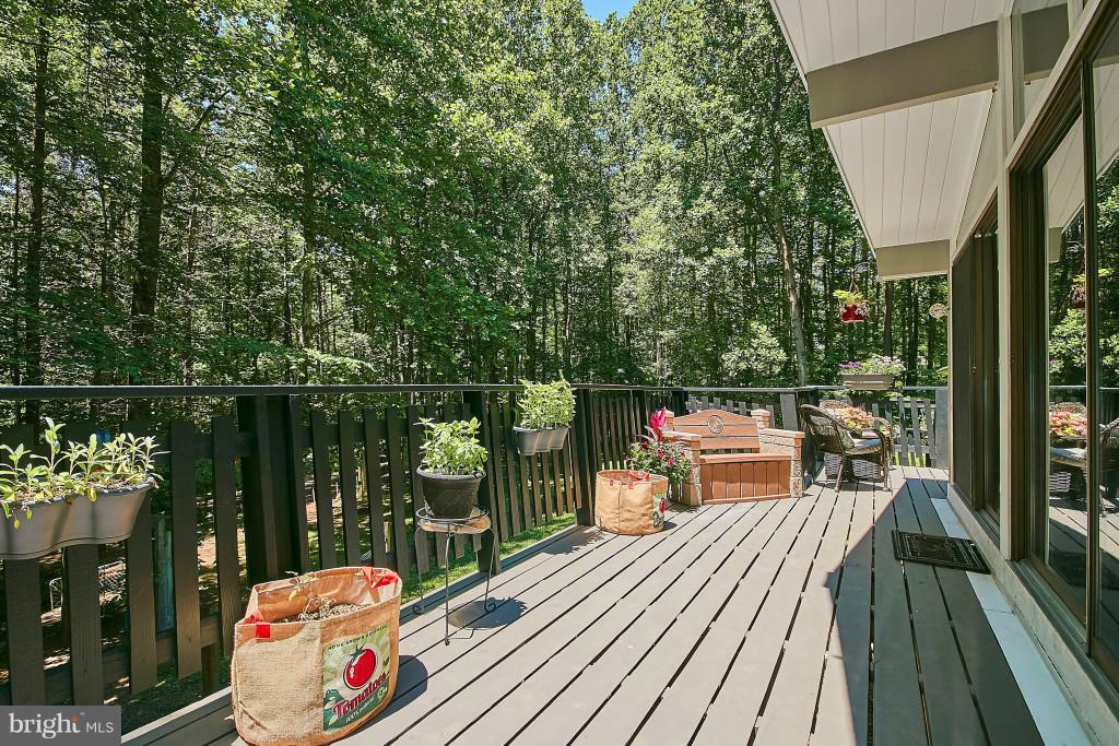 Deck connects to 2-car garage and stairs to yard. - 6704 BRIARCROFT ST, CLIFTON