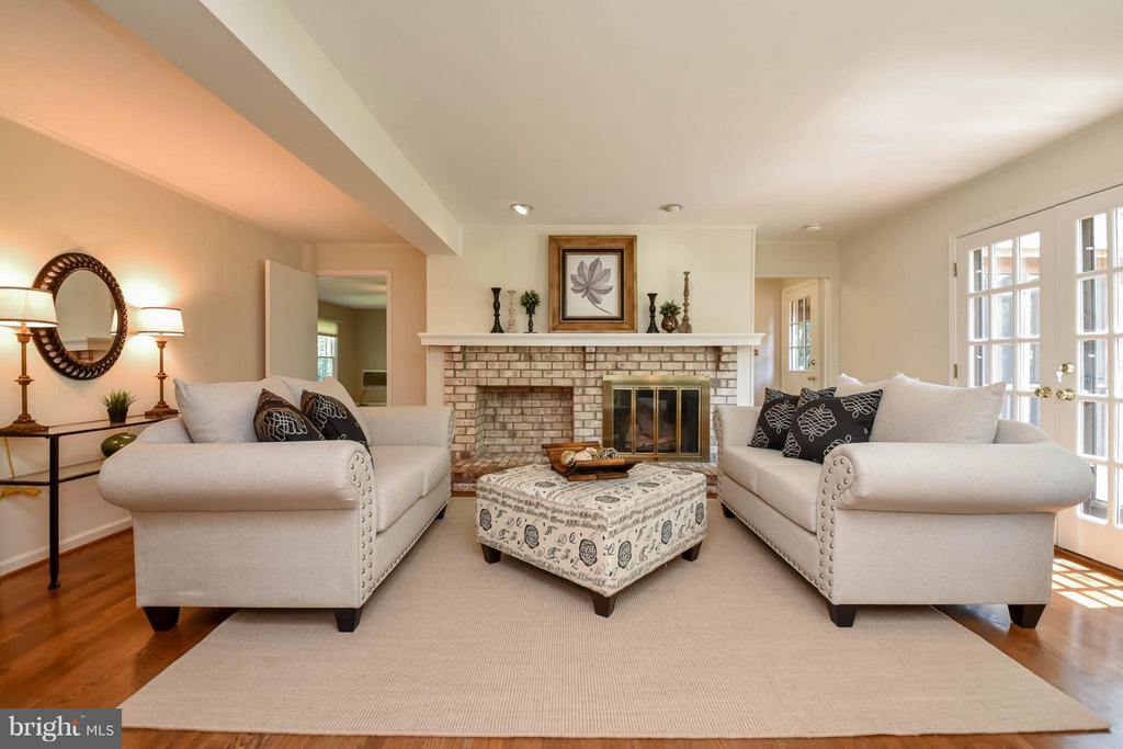 The brick fireplace accents this fantastic room - 2732 LINDA MARIE DR, OAKTON