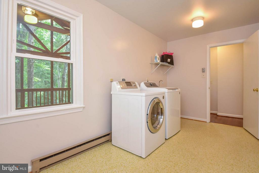 The laundry room is great and has a storage closet - 2732 LINDA MARIE DR, OAKTON