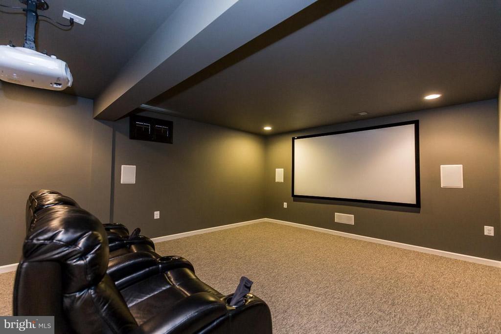 Theater room includes projector, screen, seats - 23221 FALLEN HILLS DR, ASHBURN
