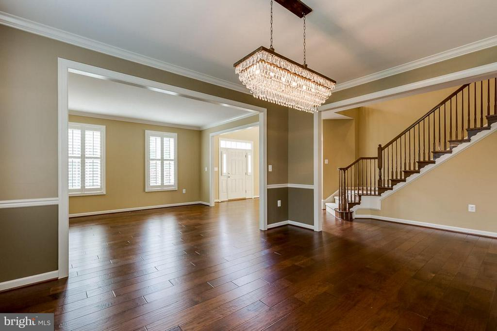 Large open dining room with beautiful chandelier! - 23221 FALLEN HILLS DR, ASHBURN