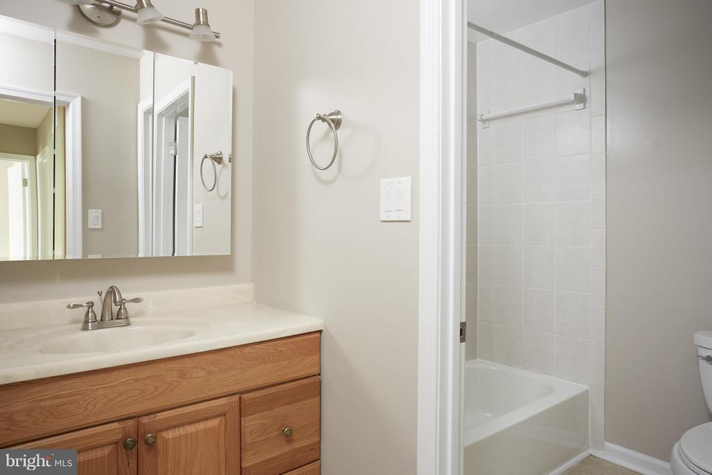 Hall bath with new tile and separate door - 1905 WESTMORELAND ST N, ARLINGTON