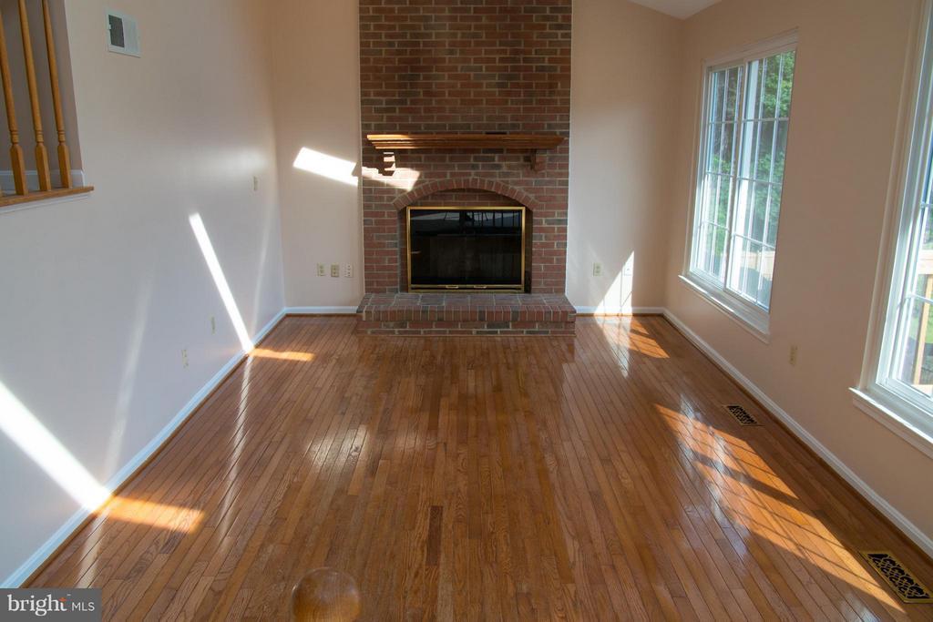 Family Room with hardwood and gas fireplace - 5404 LOMAX WAY, WOODBRIDGE